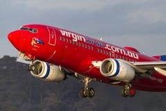 Lignes aériennes Boeing 737-7FE VH-VBZ d'Australie de Vierge décollant de l'aéroport international de Melbourne Images stock