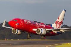 Lignes aériennes Boeing 737-7FE VH-VBZ d'Australie de Vierge décollant de l'aéroport international de Melbourne Image libre de droits