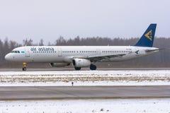 Lignes aériennes d'Airbus a321 Air Astana, aéroport Pulkovo, Russie St Petersburg 19 décembre 2017 Images libres de droits