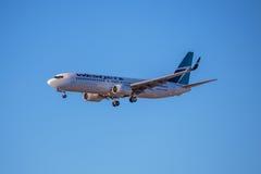 Lignes aériennes Jet Aircraft de WestJet Photos libres de droits