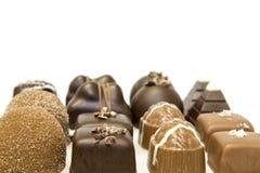 Lignes d'assortiment de chocolat Photographie stock libre de droits