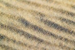 Lignes dans le sable d'une plage Texture de sable Images libres de droits