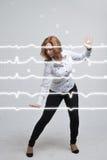 Lignes de femme et de cardiogramme de docteur Images stock