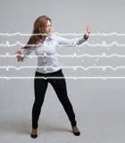 Lignes de femme et de cardiogramme de docteur Photographie stock libre de droits