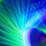 Lignes de lumières lasers tournoyées Photos stock