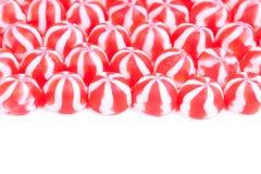 Lignes de sucrerie rouge et blanche sur le blanc Images stock