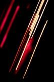 Lignes rouges et blanches sur le noir Photo libre de droits