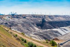 Lignite brown-coal mine in Germany. Enormous bucket-wheel excavator in an open pit lignite brown-coal mine at Garzweiler, Germany royalty free stock image