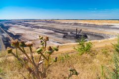 Lignite brown-coal mine in Germany. Enormous bucket-wheel excavator in an open pit lignite brown-coal mine at Garzweiler, Germany stock image