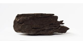Lignite or brown coal mineral on white background. Lignite or brown coal mineral also the lowest rank of coal from Russia on white background potentially for stock images
