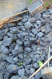 Lignite coal mineral black cube stone background Stock Photography