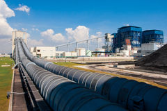 Lignite loading belt systems. Lignite loading through belt systems with dome cover to the power generator plant royalty free stock images