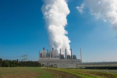 Lignite power plant for electricity generation - steam rises fro. M the cooling tower Royalty Free Stock Image