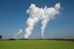 Lignite power plant for electricity generation - steam rises fro. M the cooling tower stock photo