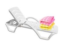 Ligstoel en handdoeken stock fotografie