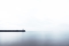 Ligthouse on pier with copy space Stock Photography