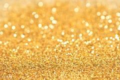 Ligths brillantes del fondo de oro abstracto Foto de archivo
