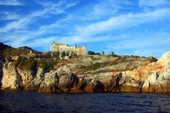 Liguria: the castle of Portovenere on the cliff rockview and Byron cave from the boat in the afternoon Stock Image
