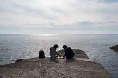Liguria Genova two person are relaxing with chess game. Two boy are rocking chess on a pier by the sea in Camogli city Royalty Free Stock Photos