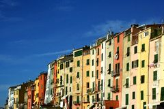 Portovenere: view of colorful buildings with blue sky and clouds Stock Photography