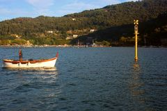 Liguria. Portovenere view fishing boat in front of Palmaria island Stock Photo