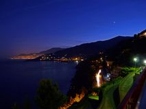 Italy, Liguria, Ventimiglia, night photo, long laying, of the coast in the direction of Monte Carlo. Liguria, Ventimiglia, night photo, long laying, of the coast stock photo