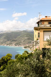 Ligurian coast. The mountains, villages and beaches. In the foreground - the yellow house and garden Royalty Free Stock Image