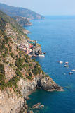 Ligurian coast. View of Ligurian coast and Vernazza village, Cinque Terre, Italy Royalty Free Stock Image