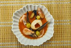 Ligurian fish stew. In Liguria, in Northern Italy, this dish of poached seafood in a garlicky tomato broth Royalty Free Stock Photos