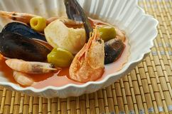Ligurian fish stew. In Liguria, in Northern Italy, this dish of poached seafood in a garlicky tomato broth Stock Images
