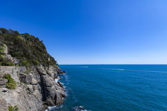 Ligurian sea. View at cliffs at Ligurian sea by Portofino in Italy Stock Photos