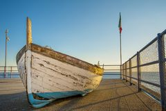 Ligurian skiff. Term skiff is used for unrelated styles of small boat Traditionally these are coastal craft used for leisure or fishing, and have a one-person Royalty Free Stock Photos