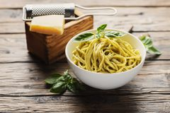 Ligurian spaghetti with basil. Traditional ligurian spaghetti al pesto with basil and cheese, rustic style and selective focus stock photo
