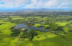Lihue, aerial helicopter view over pond and green meadows, Kauai, Hawaii stock photography