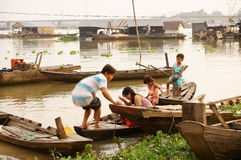 Liife on fishing village. Life at La Nga fishing village, the family go up the boat to come houseboat in La Nga, Viet Nam on September 6, 2013 Stock Image