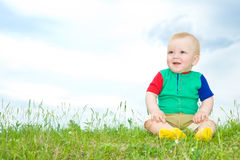 Liitle baby sit on grass Royalty Free Stock Photography