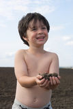 The liitle boy with  black earth Royalty Free Stock Photography