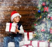 LIitle boy opening gift box Royalty Free Stock Images