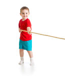 Liitle boy pulling rope isolated Royalty Free Stock Photos