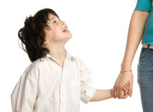 The liitle boy wish holding of mother`s hand Stock Photo