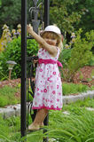 Liittle blond girl in the garden Royalty Free Stock Photos
