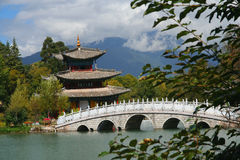 Lijiang Black Dragon Pool. The famous Black Dragon Pool and pagoda in Yunnan province, China stock photo