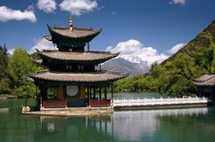 LiJiang, China: Black Dragon Pool Pagoda. The sublime Black Dragon Pool water pagoda with a view to distant Jade Dragon Snow Mountain in LiJiang, China (Lee stock image