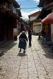 Lijiang China Old Town Mature Naxi Woman Alley Royalty Free Stock Image