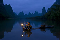 Lijiang fishing boat Stock Photos