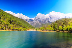 Lijiang: Jade Dragon Snow Mountain. A view of a river and Jade Dragon Snow Mountain in Lijiang (Southwest China royalty free stock images