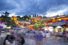 Lijiang old town in the evening with crowd tourist ,China. Royalty Free Stock Images