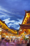 Lijiang old town in the evening with crowd tourist. Royalty Free Stock Photo