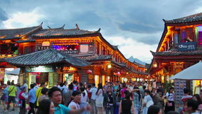 Lijiang old town in the evening with crowd tourist. stock video footage