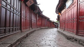 Lijiang old town streets in the morning, China. YUNNAN CHINA - JUNE 22 : Lijiang old town streets in the morning. The town be listed at the World Heritage Site stock video